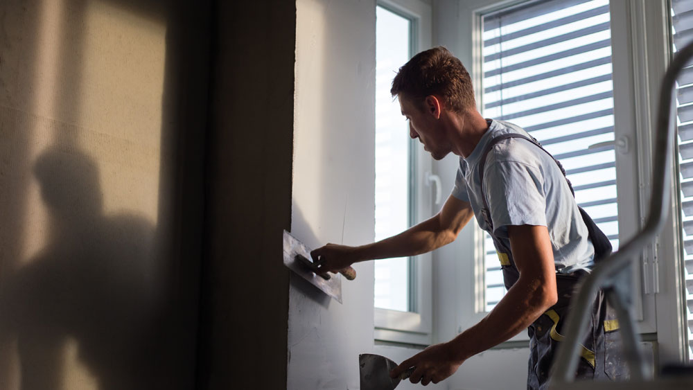Man plastering a room