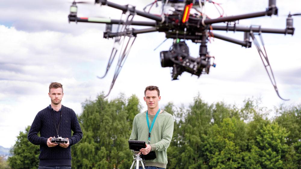 Two men flying drone