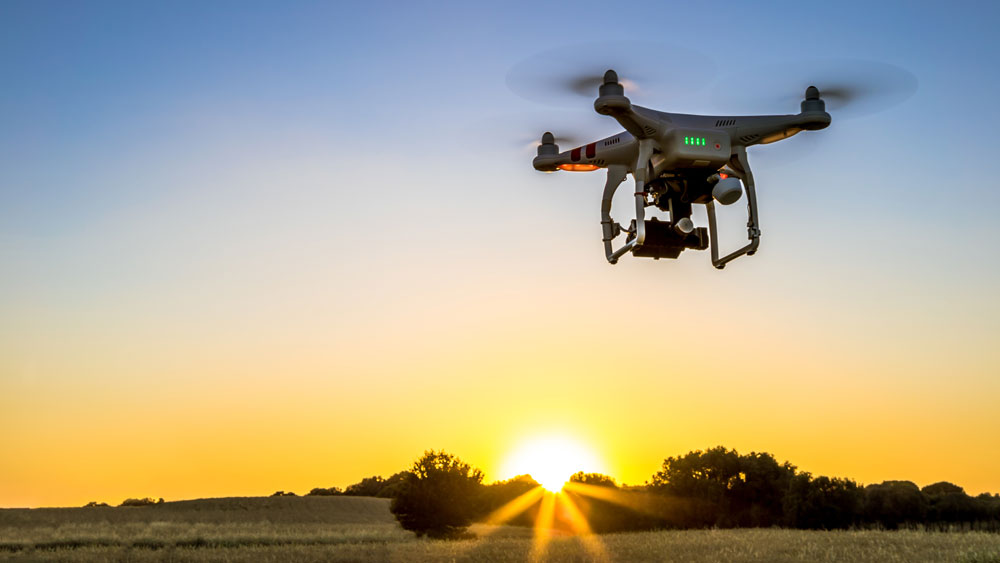 Drone flying overhead takes aerials professional photos and video